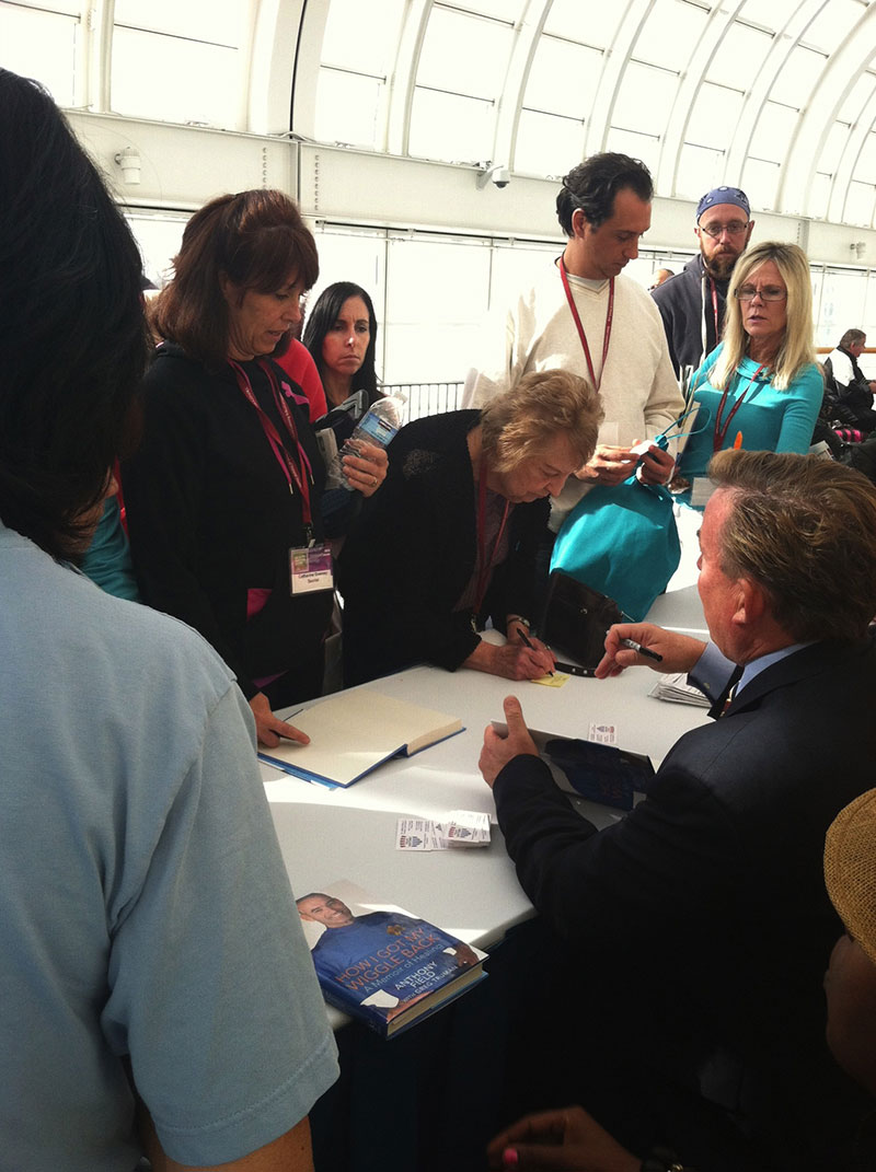 "Dr James Stoxen DC signing autographs for, ""How I Got My Wiggle Back"" at the Health Freedom Expo 2013"
